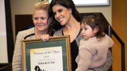 Honoree with family abd award
