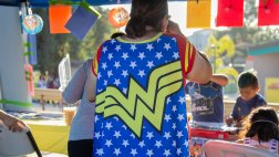 Woman wearing Wonder Woman cape