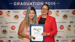Katie Wong receiving certificate