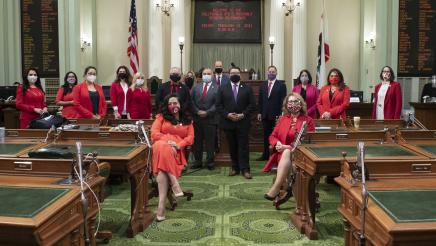 Women's Caucus on Assembly Floor wearing red